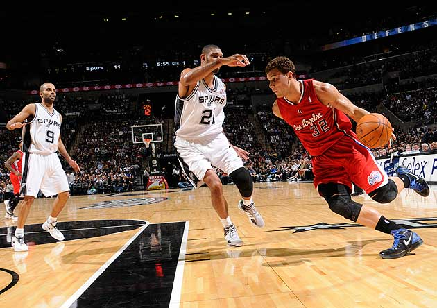 Blake Griffin drives on Tim Duncan. (Getty Images)