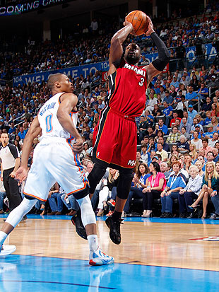 Can Dwyane Wade get loose while keep Russell Westbrook tied up? (Getty Images)