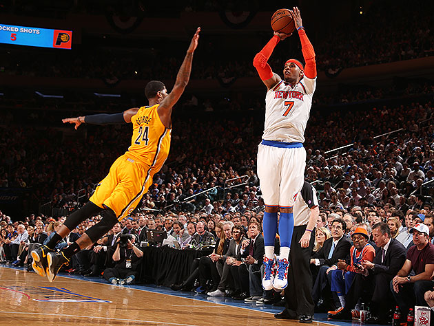 Carmelo Anthony fires over Paul George's late closeout in a Game 2 win. (Nathaniel S. Butler/NBA/Getty Images)
