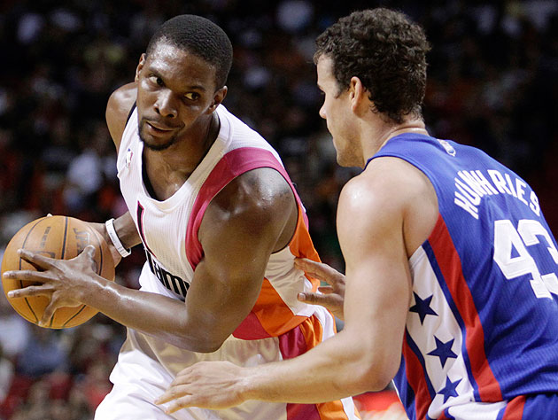 Chris Bosh of the Miami Heat and Kris Humphries of the New Jersey Nets. (AP)