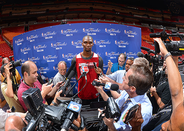 Chris Bosh speaks with the media at Heat practice on Wednesday. (Jesse D. Garrabrant/NBAE/Getty Images)