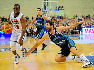 Chris Paul drives past Argentina's Federico Kammerichs. (AP)