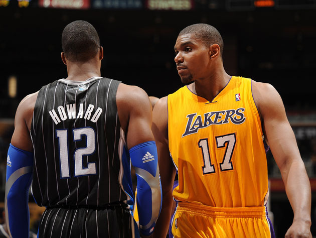 Dwight Howard and Andrew Bynum want love/money. (Getty Images)