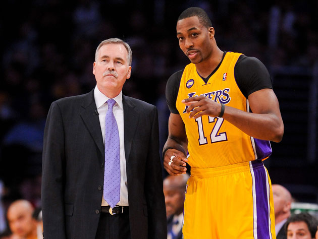 Mike D'Antoni and Dwight Howard compare notes (Getty Images)