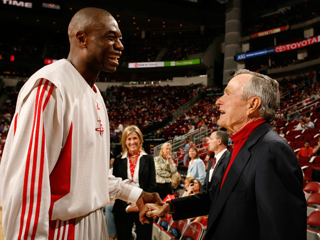 Dikembe Mutombo and former president George H. W. Bush, plotting (Getty Images)