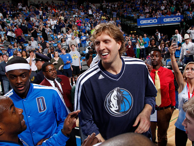 Dirk Nowitzki works the charm on free agent to-be Mike James (Getty Images)