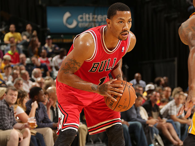 Derrick Rose studies the defense in his first game in over 17 months (Getty Images)