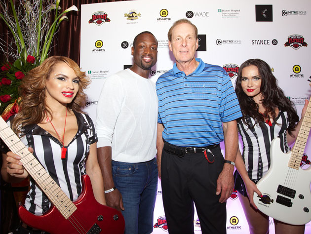 Dwyane Wade, Rick Barry, two referees and two off-brand guitars (Getty Images)