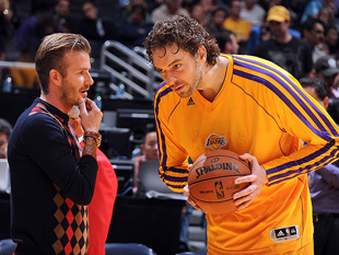 David Beckham and Pau Gasol discuss the spread pick-and-roll, probably. (Getty Images)