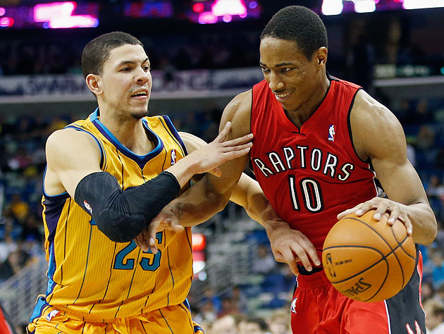 DeMar DeRozan smiles because he knows exactly what Austin Rivers will do here. (Chris Graythen/Getty Images)