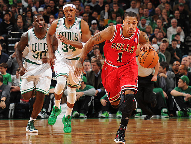 Derrick Rose says he'll be back running the break come October. (Brian Babineau/NBAE/Getty Images)