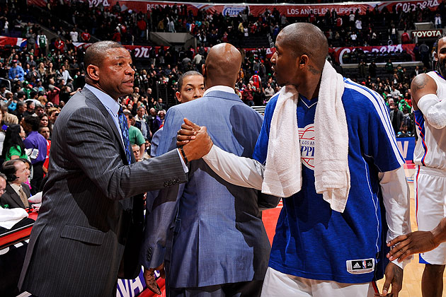 Doc Rivers tells Jamal Crawford what we all know: that the Clippers look *good.* (Andrew D. Bernstein/NBA/Getty)