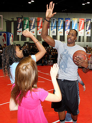 Dwight Howard high-fives young fans during the NBA's 2012 All-Star Weekend, (Getty Images)