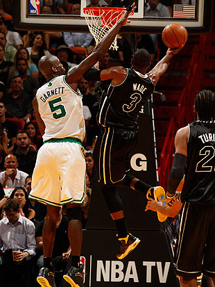 Dwyane Wade drives past Kevin Garnett. (Getty Images)