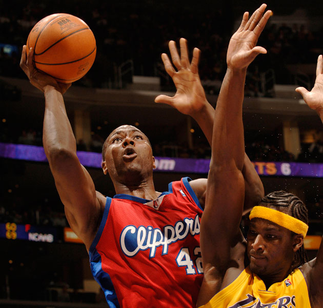 Elton Brand shoots while Kwame Brown throws up his hands. (Getty Images)