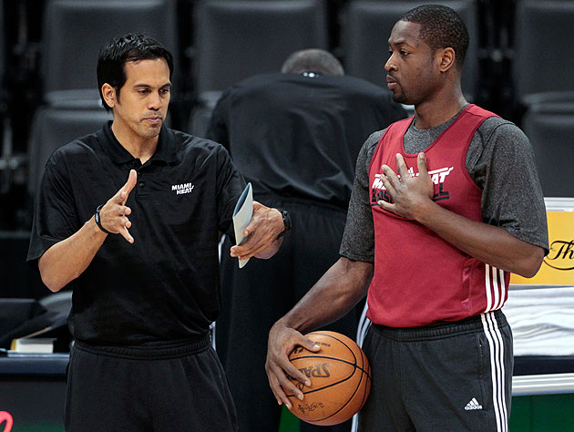 Erik Spoelstra acts out what he wants Dwyane Wade to do. (AP)