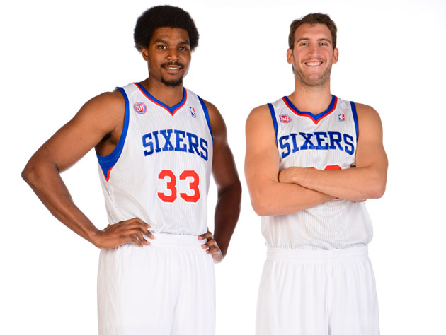 Andrew Bynum and Spencer Hawes make plans to star in a '70s buddy cop movie (Jesse D. Garrabrant/ Getty).