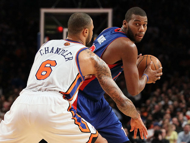 Greg Monroe sizes up his options against New York's Tyson Chandler (Getty Images)
