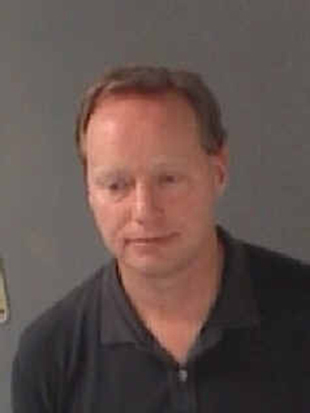 Hawks head coach Mike Budenholzer's mugshot. (Photo via Atlanta City Jail)