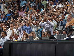 Hornets fans cheer during a 2011 Western Conference Quarterfinals game against the Lakers. (Getty Images)