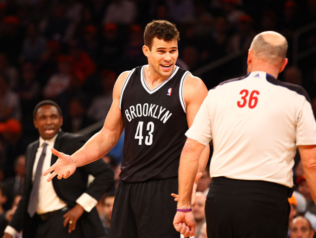 Kris Humphries kvetches while Avery Johnson makes his decision (Getty Images)