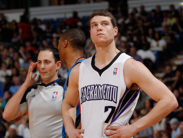 Jimmer Fredette wonders who's minding the store, as Steve Buscemi looks on (Getty Images)