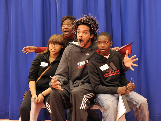 After four games in five nights, Joakim Noah pals around with the kids on Sunday (Getty Images)