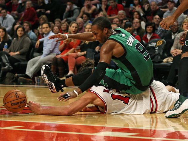 Joakim Noah and Rajon Rondo try to establish low post position (Getty Images)