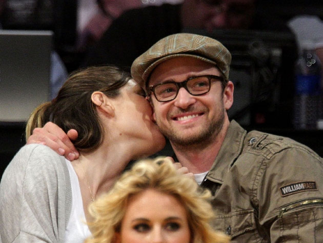Justin Timberlake and unidentified woman at a Lakers game in May of 2012 (Getty Images)