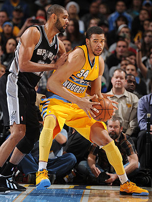 JaVale McGee posts up Tim Duncan, kind of (Getty Images)