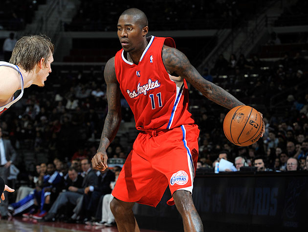 Jamal Crawford prepares to do something evil to Kyle Singler. (Allen Einstein/NBA/Getty Images)
