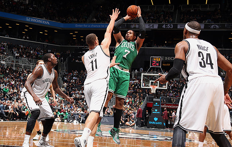 Jared Sullinger shoots over Brook Lopez. (Nathaniel S. Butler/NBAE/Getty Images)