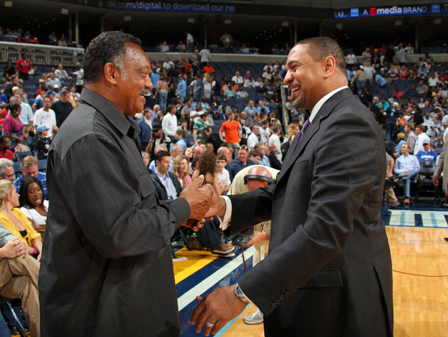 Jesse Jackson and Mark Jackson, literally hours after Mark paid $5000 for a folder containing nude photos of himself (Getty Images)