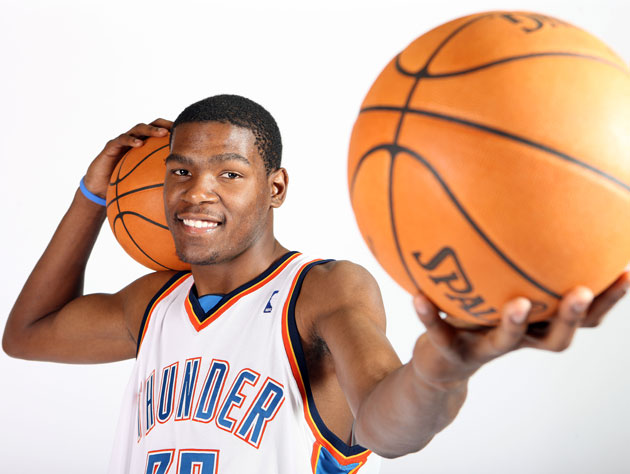 A very young Kevin Durant poses in a new Thunder jersey in 2008 (Getty Images)