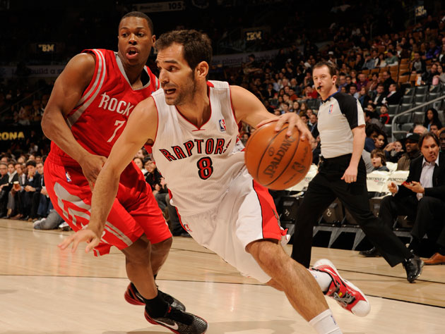 Jose Calderon blows past Kyle Lowry in a picture he's probably framed by now (Getty Images)