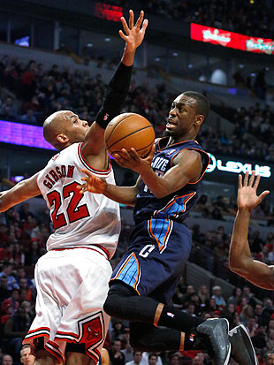 Kemba Walker and his fellow Bobcats guards sliced through the Bulls D on Monday. (AP/Charles Rex Arbogast)