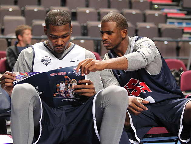 Kevin Durant and Chris Paul study their opposition. (Getty Images)