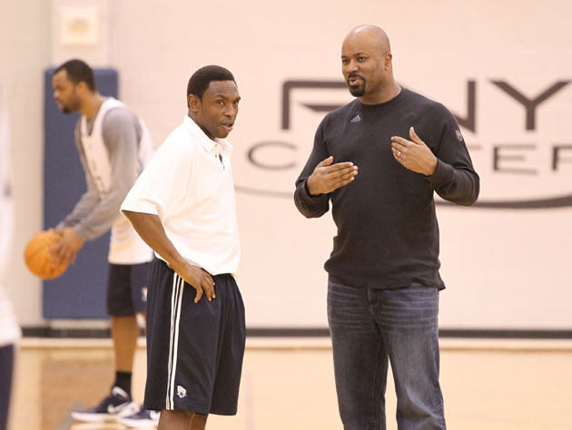 Avery Johnson and Billy King, surveying what's left (Getty Images)