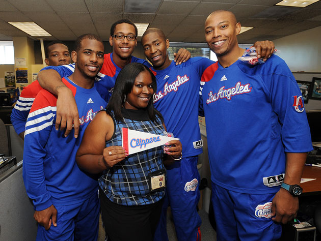 The Clippers present a fan with the only memento Donald Sterling would pay for (Getty Images)