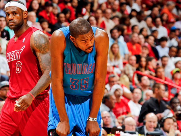 LeBron James and Kevin Durant wait out the final seconds of the 2012-13 regular season (Getty Images)