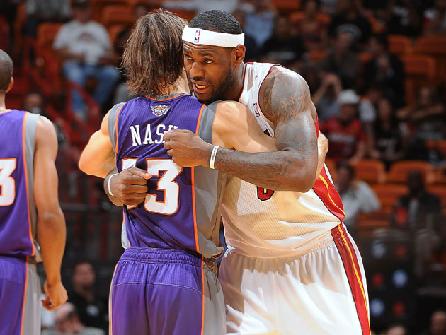 LeBron James tells Steve Nash just where he likes to receive his passes. Not tampering, though (Getty Images)