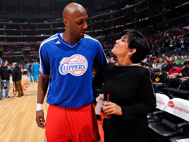 Lamar Odom chats with an unidentified fan before a game last week (Getty Images)
