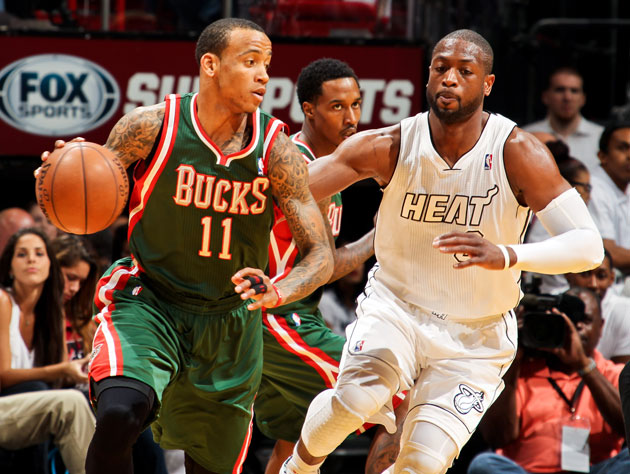 Monta Ellis and Dwyane Wade avert their eyes (Getty Images)