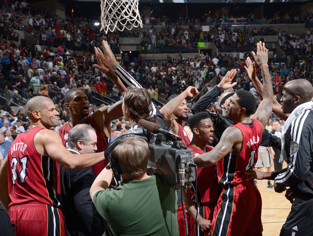 The Miami Heat, sans LeBron James and Dwyane Wade celebrate their win (Getty Images)