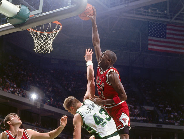 Michael Jordan dunks over Buck center Jack Sikma at the Bradley Center in 1989 (Getty Images)