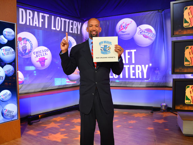 Hornets coach Monty Williams is not posing with the card that earned the team the 10th overall pick (Getty Images)