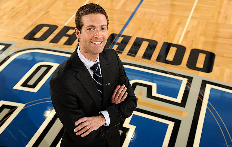 Magic GM Rob Hennigan lets a smile be his umbrella. (Fernando Medina/NBAE/Getty Images)