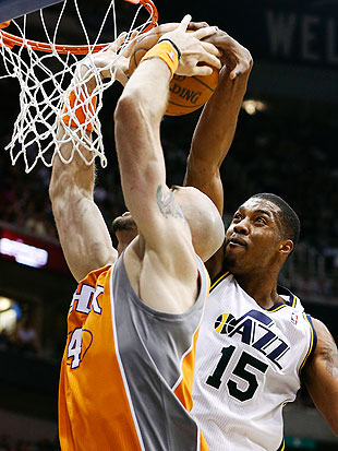 Marcin Gortat is going to have nightmares about Derrick Favors. (AP)