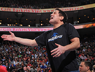 Mark Cuban looks up at the Jumbotron for a replay. (Getty Images)