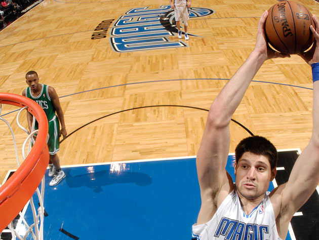 Nikola Vucevic clears the boards (Getty Images)